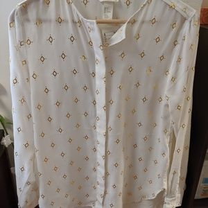 White button-down with gold